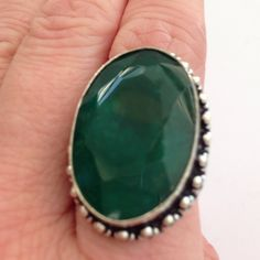 % 925 Sterling silver ring size 7.5 % Emerald Sparkling, faceted, % Emerald Ring in size 7.5, inlaid into vintage style % 925 Sterling silver with stamp of 925  Measures 1 &1/4 X 1 in ( L X W ) Beautiful hand crafted ring, NWOT Hand made Jewelry Rings