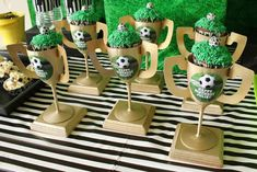 Love that the cupcakes are placed in gold soccer cups at this Soccer Birthday Party! Love the  decor! See more party ideas and share yours at CatchMyParty.com  #catchmyparty #partyideas #soccer #soccerparty #soccercupcakes