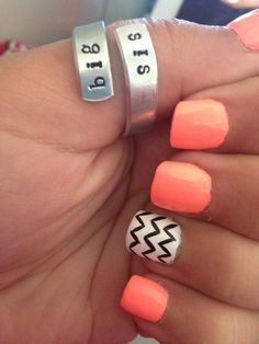 Peach solid nails with an accent finger of black and white chevron or stripes! Love the ring too!