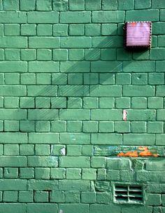 painted brick wall - teal
