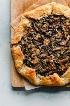Mushroom Galette - rustic and flavorful, this cremini and shiitake mushroom galette is filled with sharp blue cheese and wrapped in a flaky sour cream pastry dough. This rustic mushroom tart is great for entertaining! Strudel, Quiches, Gallette Recipe, Galette Pastry Recipe, Mushroom Tart, Savory Tart, Savoury Pies, Cheese Tarts, Tart Recipes