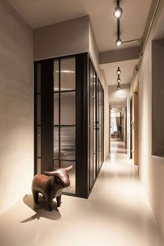 Interior with smart glass and steel partitions and a minimal vibe