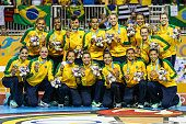 Players of Brazil pose with their gold medal after a handaball match between Brazil and Argentina in women's handball during Day 14 of the Toronto...