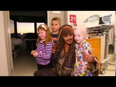 Johnny Depp surprises sick children in Australian hospital