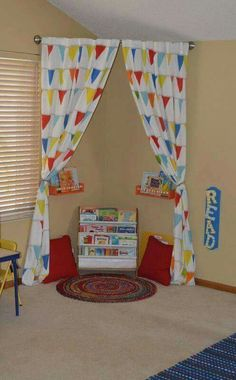 A curved shower rod, some fabric and soft pillows can turn any corner into a cozy reading nook. Via The Keeper of the Cheerios-Blog
