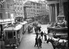 Rome, at the Pantheon, with horse-drawn carts and a streetcar.