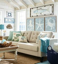 Big on wall art in this sandy beige living room by Pier 1... http://www.beachblissdesigns.com/2016/09/pier-1-catalog-beach-living-room-wall-decor.html