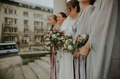 Bride and maids carry white and red flower winter bouquets . Images by Jamie Sia