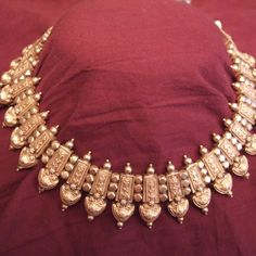 "22ct gold,Goa, India Description  Very elegant"" stridhana"" necklace from Goa,  part of the woman 's dowry.Adjustable and extremely confortable for an every day wearing."