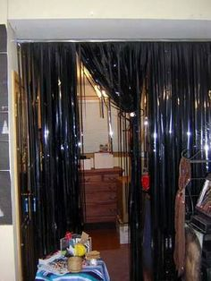 make a curtain out of old vhs tape/curtain rod/duct tape - pretty cool