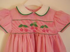 Sweet Cherries smocking plate on pink and white micro gingham and made into a basic yoke dress.