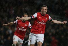 ~ Lukas Podolski of Arsenal FC celebrating his goal against Wigan Athletic ~