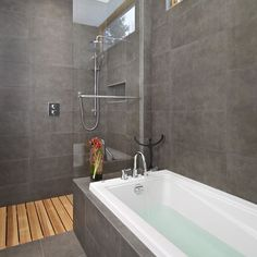 Ceramic Tile Walk In Showers Design -- I like a walk-in shower with no door and I'm liking the teak slats on the floor also.