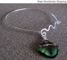 Items similar to Peacock Feather Bangle. Wave Shaped Bangle with dangle on Etsy Silver Bangle Bracelets, Peacock, Wave, Dangles, Feather, Shapes, Drop Earrings, Jewellery, Sterling Silver