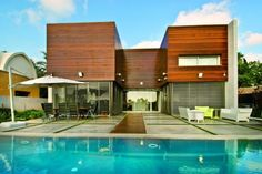 Modern Concrete and Wooden House Design by Nestor Architecture. Israel