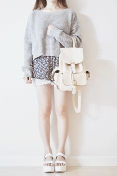 I really love the white platform shoes with the white backpack and the patterned shorts.
