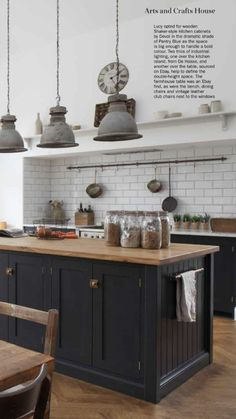 i like the pots and pans rail above the stove idea