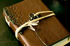 leather-covered bible with vintage key