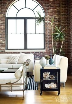 Dark #brick + white furniture (lovely #sofa) + parquet. Perfect details!