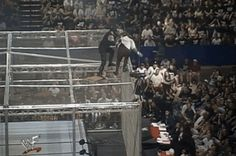In 1998 The Undertaker threw Mankind off Hell In A Cell and plummeted 16 ft through an announcers table. Undertaker Wwe, Wrestling Posters, Wrestling Videos, Wrestlemania 29, The Falling Man, Mick Foley, Dance Choreography Videos, Wrestling Superstars, The Cell