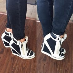 L.A.M.B Sneakers Black and ivory wedge sneakers by L.A.M.B. These sneakers look great worn with jeans. They are very comfy and have only been worn a handful of times. In perfect condition. L.A.M.B. Shoes Sneakers