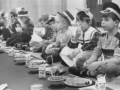 Students dressed in construction paper bonnets, Pilgrim hats and Indian headdresses eat a traditional Thanksgiving dinner - almost - at a North Grove Elementary School Thanksgiving party in this 1986 photo.  The menu included all the usual Thanksgiving fare along with vegetable soup and peanut butter cookies.