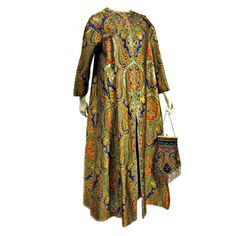Nina Ricci 70s Couture Paisley Evening Coat w/ Matching Handbag  France    A wonderful Nina Ricci Couture piece from the early 70s; a paisley pattern, rhinestone embellished full length evening coat with a matching (Not Nina Ricci, but a vintage 20s) elaborately beaded handbag.