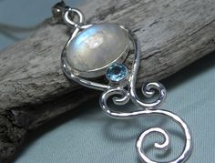 NECKLACE - Rainbow Moonstone Sterling Silver Swirl Necklace - Blue Topaz Moonstone Necklace - Unique Moonstone Jewelry. $109.00, via Etsy.