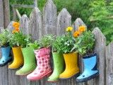 Love how the color transforms the dull fence.   Great way to #recycle outgrown boots.