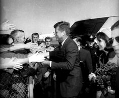 JFK and his wife, Jackie, are greeted upon their arrival at Love Field airport in Dallas, Texas, in this November 22, 1963, photo. Later that day, the president would be assassinated.