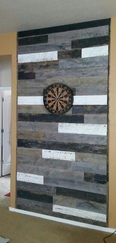 Barnwood dart board wall. My hubby is very talented!