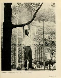 "Spectrum Green yearbook, 1977. ""Enjoying warm fall weather a student does chinups on a tree on College Green"" :: Ohio University Archives"