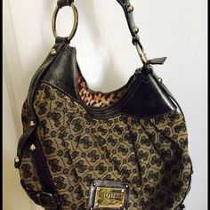 Charcoal signature Guess hobo purse Part leather, part canvas hobo with leather strap. Very comfortable shoulder strap. Zip up top closure. Good condition. Guess Bags Hobos