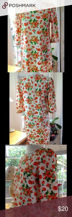 60's style shift short floral dress British brand Super cute and ready for spring... short dress with 3/4 sleeves. Has neon color small flowers with green leaves. Back short zipper. Super fun and comfortable dress. In excellent condition New Look Dresses Mini