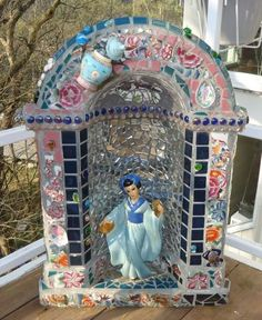 Mosaic Grotto $40 will let go for 25 This was a concrete grotto that i mosaiced on both sides and all over. It's very heavy, but makes a lovely addition to a garden. Stands 30 inches tall and 22 inches wide. Bring someone with you to help carry.