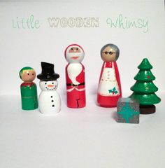 """6 piece Christmas Peg Doll set, features Santa and Mrs Claus, an elf, a present, a snowman and a Christmas Tree.  Hand painted and glazed with a non toxic brush on gloss. Largest piece measures approx 3.5"""" tall."""