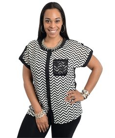 This cute boxy fit woven top features a rounded neckline with zigzag pattern print and contrast trim. Buttoned front closure with single lace patch pocket.