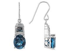 7.60ctw Oval London Blue Topaz With .08ctw Round Blue Diamond Accent Sterling Silver Earrings