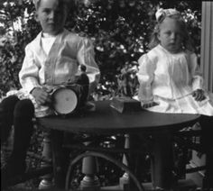 Zieber family of Keizer. Montague Lord and Charlotte Zieber playing on porch of Bush House, Salem, Oregon. :: Bush Family Historic Photographs