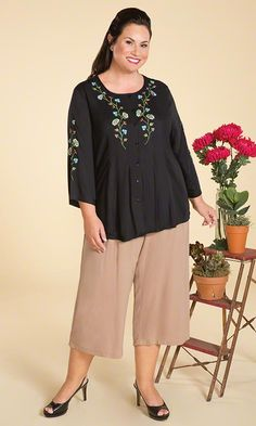 Sydney Blouse | Our Sydney Blouse is sleek and versatile with delightful floral accents! Embroidered floral accents on front and sleeves / Flattering flowing design / Button front / Bracelet length sleeves / 100% rayon / MiB Plus Size Fashion for Women #plussize #plussizefashion #spring