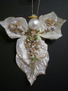 This listing introduces the first of our Holiday Floral Leaf angels. There are no two alike.    Missy is made from cream colored velvet leaves edged