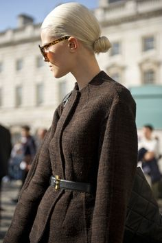 collarless jacket. sleek bun.