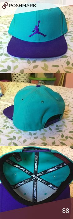 Jordan SnapBack NWOT Cute hat, I bought it and just never had the opportunity to wear it. Teal and dark purple. Willing to negotiate! Jordan Accessories Hats