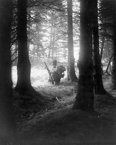 Staff Sergeant George Talbert of 3rd Battalion, 18th Infantry Regiment, 1st Infantry Division, on the lookout for German troops in a forest near Sourbrodt, Belgium during the Battle of the Bulge - 19 December 1944