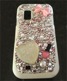 Hand-Decorated Cell Phone Cases. Decorating with nail products. Nailsmag.com