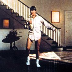 Risky Business costume, you just need a men's button-down dress shirt and a pair of tube socks. I recommend wearing a small pair of exercise shorts under your shirt instead of tighty whiteys, though! Add a pair of wayfarers to this outfit, too — although Tom Cruise doesn't wear them in this particular scene, Risky Business is credited as one of the main reasons why Ray Ban wayfarers made a huge comeback in the '80s! Movie Character Costumes, Themed Halloween Costumes, Hallowen Costume, Last Minute Halloween Costumes, Costume Ideas, Halloween Ideas, Costumes Kids, Movie Themed Costumes, Classic Halloween Costumes
