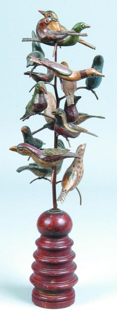 "Hand Carved Bird Tree by David Ludwig, 15 carved and polychrome painted pine birds on bent sassafras, turned bedpost, 21-½""h Estimate; $500-$1000 Sold; $1540.00"