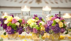 Spring flowers with floating lemons. Yellow roses, purple lilacs, Green Trick Dianthus, and Green Kermit mums.