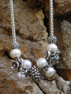 Small berry, pearls, forget me not, triple pearls and large berry make for a lovely necklace....Trollbeads -   Swiss Flower and Gift Cottage
