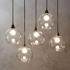 """Shop firefly pendant light.   Industrial modern chandelier suspends five glass globes from black iron canopy.  Pendants stagger in length on black cords 15"""" to 29"""".  Great look with filament bulbs.  Hanging hardware included.  Learn about  on our blog. #LampIndustrial"""